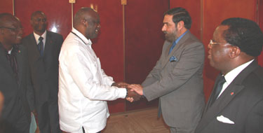 President of Ivory Coast Laurent Gbagbo at a ceremony honouring India's Minister of State for External Affairs Anand Sharma with the country's highest civilian award
