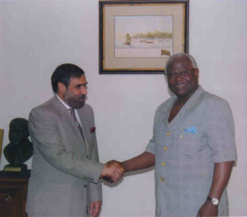 India's Minister of State for External Affairs Anand Sharma shaking hands with Sierra Leonean Presdient