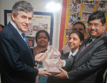 British Prime Minister Brown receiving stature of Goddess Saraswati from Bal Bharati Public School Princiapl L V Sehgal