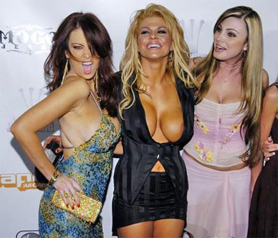 "Porn star Jenna Jameson (L) poses with two new models for her ""Club Jenna"""
