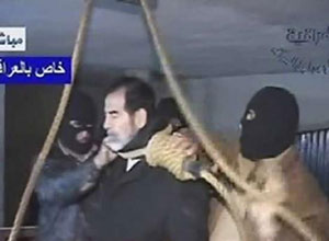 A frame grab from Iraqi state televison shows a noose being placed around Saddam Hussein's neck